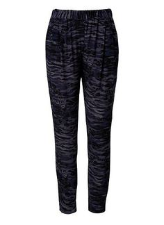 Viscose Crepe Printed Pleat Pant. Comfortable fitting silhouette features an elasticised waistband, front pleats with side pockets in an all over Camo print. Available in Multi as seen below.