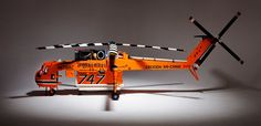 This meters), meter) Lego model of an Erickson Air-Crane helicopter is truly outstanding. It is not as big as the Lego battleship Yamato—still the largest Lego model ever built—but the engineering of this helo is extraordinary. Erickson Air Crane, Coast Guard Helicopter, Orange Brick, Orange Coast, Cool Lego, Awesome Lego, Lego Models, Lego Brick, Knock Knock