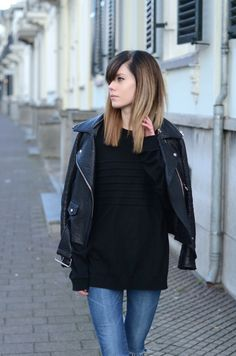 Black sweater and leather coat
