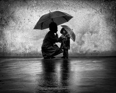 mother and child in the rain.