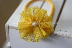 The Vintage Lace Flower Headband in yellow is perfect any occasion! They are made from the same lace as our rompers and other lace products so they will match perfectly! Each skinny nylon fabric headb