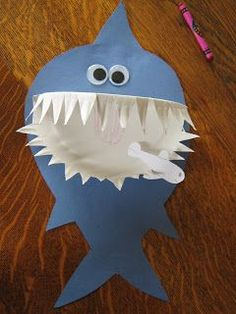 This is a funny shark craft you can make from a paper plate and some blue paper.   Materials:    1 paper plate  blue construction paper  pe...