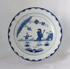 """18thC Bow Porcelain Plate The Golfer & Caddy Pattern Chinoiserie c.1758 Marked with number 12 to the reverse.  It measures 10 1/8"""" wide and just over an inch deep. Condition is good but with a few small areas of damage to note: 3 short hairlines from the edge, longest 1 1/2"""", a shallow glaze chip to the rim at the bottom and a couple of other tiny frits to the rim.  £656  BIN"""