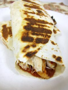 Chicken Parmesan Wrap  (Printable Recipe)    1 lb chicken tenders  3/4 cup Italian dressing  1 jar pizza sauce  6 mozzarella cheese slices  grated parmesan cheese  6 tortillas