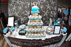 Beach Inspired party | The cake/cupcakes. Love the seahorse cake topper!