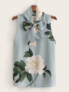 To find out about the Floral Print Tie Neck Sleeveless Blouse at SHEIN, part of our latest Blouses ready to shop online today! Floral Blouse Outfit, Sexy Blouse, Long Blouse, Sleeveless Blouse, Chiffon, Bow, Pullover, Couture, Blouse Designs