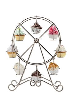 Ok, not gonna lie - I'm digging this ferris wheel cupcake holder. $39.99 from ideeli today.