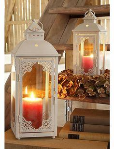 Buy lanterns in the markets and spray paint white. lovely.