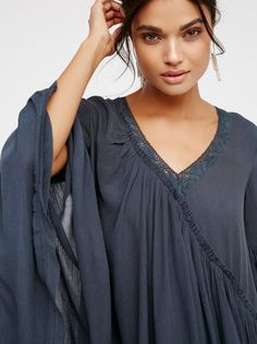 Believe In Me Tunic | Gorgeous, femme tunic featuring ethereal, flared sleeves, crochet accents along the neckline and unfinished edges for a lived-in look. * Asymmetrical hem and details * Adjustable tie detail at the neckline * Soft and semi-sheer * Shapeless fit