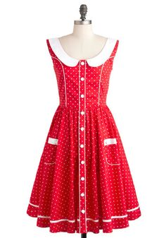 """Red dress with white polka dots and piping, white Peter-pan collar, V-shaped back, and square pockets. 39.5"""" long. $90."""