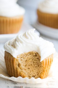 """These paleo vanilla cupcakes are so light, fluffy, moist, and sweet that you'd never guess they're gluten free, dairy free and paleo! The """"buttercream"""" frosting is easy to whip up, and tastes just like the original even though it contains no refined sugar or dairy."""
