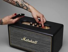 The Marshall Stanmore Bluetooth Speaker System is a stylish speaker with the classic Marshall Stanmore amp aesthetics and excellent performance. New Bluetooth Speakers, Stereo Speakers, Loa Bluetooth, Bluetooth Gadgets, Marshall Headphones, Marshall Speaker, Music Headphones, Home Theater Setup, Home Theater Speakers