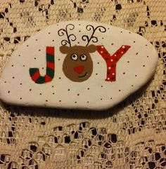 Joy with reindeer painted on a Lake Huron beach stone by Cindy P 2017