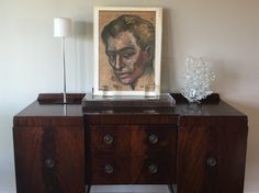 1950's original art, set on vintage European buffet, with estate sale find leaded crystal object, and Design Within Reach lamp; elegant and interesting tablescape for traditional dining room.