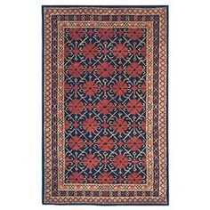 Hand-tufted wool rug with a floral motif and three-tier border.  Product: RugConstruction Material: 100% WoolColor: Navy and dark redFeatures: Handmade Note: Please be aware that actual colors may vary from those shown on your screen. Accent rugs may also not show the entire pattern that the corresponding area rugs have.Cleaning and Care: Professional cleaning recommended. Spot clean minor spills.