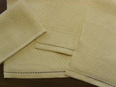 Regarding wet-finishing handwoven towels before or after hemming, here is my rationale for doing hemming after washing.   I always wet-finis...