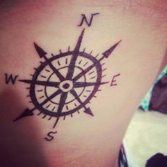 Compass tattoo but maybe arrows instead of NE/NW lines.
