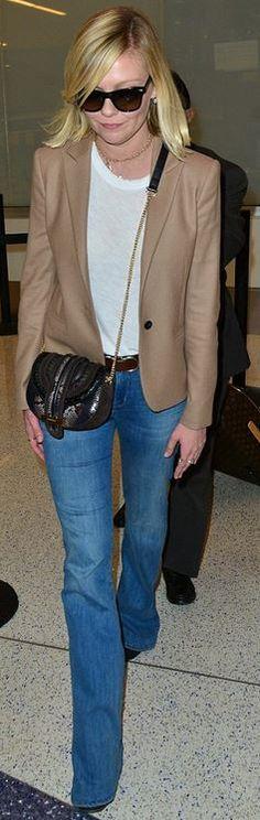 Kirsten Dunst: Purse – Salvatore Ferragamo  Jeans – Madewell  Suitcase – Louis Vuitton