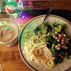 fettuccine alfredo with broccoli and chickpea.  strawberry mango protein smoothie to drink.