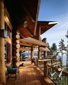 roger wade studio architectural photography of luxury log home deck with lake views, private cabin, woods bay, montana, by rocky mountain log homes