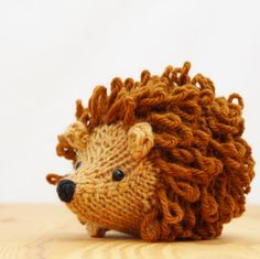 Little knitted hedgehog in golden tan and cocoa brown by Yarnigans