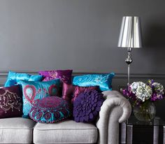 Deep jewel tones; royal purple, teal, hot pink and grey as a neutral.