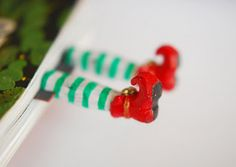 Elf in the book mark. I like this idea, but I think it would be even better if it was striped stockings with ruby slippers, like wizard of oz. I may have to make one for myself.