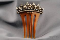 https://www.barnebys.co.uk/realisedprices/lot/7820380/antique-diamond-and-pearl-hair-comb/