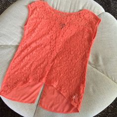 Orange & Lace High Low Blouse This top is so so cute, and versatile! It's a single colored, textured piece, so it could be styled many different ways. The front is a see through lace, with the back being slightly sheer. Scoop neck. Fab condition. ;) Runs just a little big for a small. Tops Blouses
