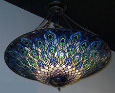 Tiffany lampsTiffany Studios produced thousands of lamps in many shapes and designs. Variations in the design, shape and type of glass promoted the uniqueness and no two Tiffany lampshades are identical. Tiffany offered a variety Peacock Bedroom, Peacock Decor, Peacock Colors, Peacock Art, Peacock Design, Peacock Purse, Peacock Theme, Peacock Feathers, Peacock Blue