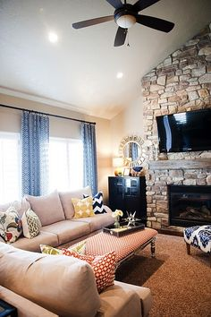 Pretty, I'd like it better w/o the tv above the mantel and a darker color on the walls.