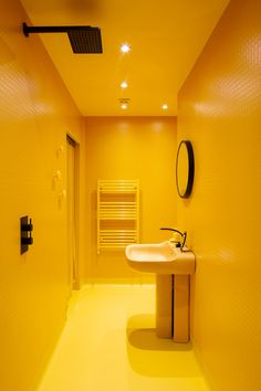 An eccentric's yellow bathroom with walk in shower. The This Must Be What It's Like to Live Inside a Rainbow - Design Milk Contemporary Bathrooms, Modern Bathroom, Small Bathroom, Parisian Bathroom, Contemporary Rugs, Master Bathroom, Bathroom Ideas, Yellow Bathroom Decor, Yellow Bathrooms