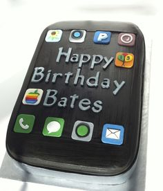 iPhone Cake - I made this cake for a 13 year old boy who loves anything made from Apple. He is into vintage Apple products so I made the old rainbow striped Apple logo for him. It is a white cake covered in black fondant. All of the apps are made out of fondant as well.