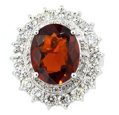 Ring of 54 Round Brilliant Diamonds 2.44ct.tw., Center Spessartine Garnet 6.42ct. (=)