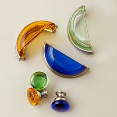 Affordable glass pulls add color and cottage-style character. | Photo: Andrew McCaul | thisoldhouse.com