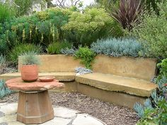 Concrete bench created from recycled cut/resawn sidewalk | by David Feix Landscape Design