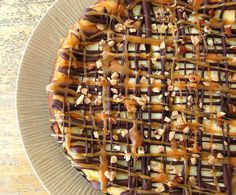 Vegan Turtle Cheesecake with Pecans, Fudge, and Caramel Drizzle