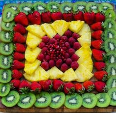 "If this would be on an angle lined with more kiwi, etc... it could look like a grad cap. Black ""tassle"" could be made out of...string licorice? Find a year to attach to ""tassle"" Fruit Presentation, Fruit Arrangements, Food Platters, Fruit Trays, Fruit Dishes, Fruit Platter Designs, Platter Ideas, Fruit Designs, Fruit Decoration For Party"