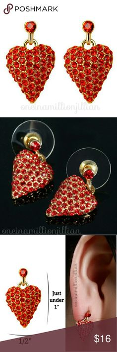"""Gold Pave Puffed Heart Dangle Earrings New in Pkg/Sealed  Goldtone puffed heart paved in red rhinestones provides the perfect amount of sparkle to make these eye catching. Just under 1"""" in length makes them great to wear both every day, as well as on special occasions. Post style + cushion backs make them comfortable to wear.  Check my page for more items to bundle with! #oneinamillionjillian Jewelry Earrings"""