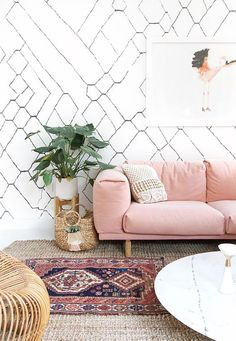 fun bohemian space with a pink sofa