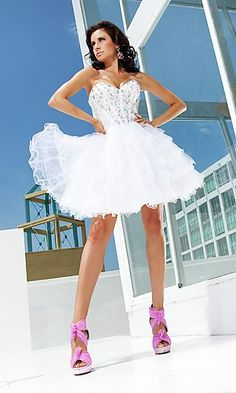 Short White Prom Dress with Corset Top by Tony Bowls TB-TS11259  www.dresseswd.com  Style: TB-TS11259  Name: Short Strapless White DressClosure: Lace Up Back   Details: Sequin Bodice, A-line Ruffled Skirt   Fabric: Sequin and Tulle   Length: Short   Neckline: Strapless Sweetheart   Waistline: Natural