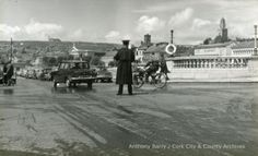 Photograph, junction of Patrick's Bridge and Patrick Street, Cork showing Garda directing traffic. Cork City, Cork Ireland, Old Photos, Celtic, Bridge, Photograph, Street View, Thoughts, Old Pictures