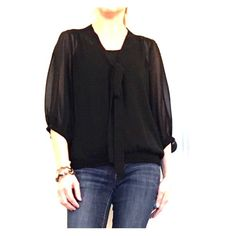 Sheer black blouse with tie detail Sheer black blouse with tie detail.  3/4 length sleeve and in excellent condition.  Please make me an offer! Old Navy Tops Blouses