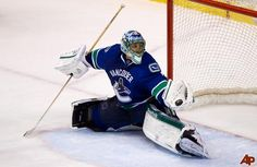 Vancouver Canucks' goalie Roberto Luongo makes a glove save against the Los Angeles Kings during the third period of an NHL hockey game in Vancouver, B., on Monday March THE CANADIAN PRESS/Darryl Dyck Hockey News, Hockey Goalie, Hockey Games, Los Angeles Kings, Vancouver Canucks, Golf Bags, Nhl, Sports, Airbrush