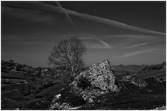 "Nothing remains of Pilsbury castle but the earth works But for that reason alone it is worth a visit. On the day of my visit i decided that the strong Contrast between the sky and the prominent rock Required a black and white image.  Although the site would also look good as a sunset Image. Just a note my "" Crowdecote "" banner image was Obtained only a few miles further up the river Dove."