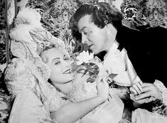 Gorgeous Paulette Goddard, even more gorgeous flower and Ray Milland in Kitty (1945).