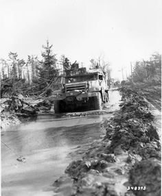 A 1st Infantry Division half-track plows its way through a muddy road in the Hurtgen Forest 15 February 1945.