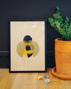 Manchester bee artwork by Jane Blease. Hand printed onto wood veneer and available to buy at Manchester Craft and Design Centre, Manchester.