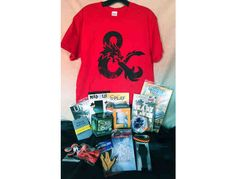 Need something for your teen? Look now further than is item. Package includes  	Red Medium 100% cotton t-shirt with dragon head on it 	Paracord bracelet 	Startrek air freshner 	Hex bug 	Book-Ready Player One by Ernest Cline 	Stealth Wrist Watch 	...