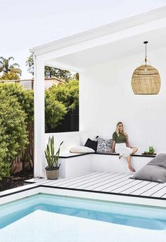 A Queensland pool house with New York loft style Made in the shade: Poolside relaxing is a breeze for homeowner Hannah, with slouchy linens, coastal weaves and crisp white HardieDeck. Pool Gazebo, Backyard Pool Landscaping, Swimming Pools Backyard, Swimming Pool Designs, Landscaping Ideas, Backyard With Pool, Swimming Ponds, Lap Pools, Sloped Backyard